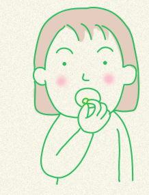 舌下にエキスを入れる女性